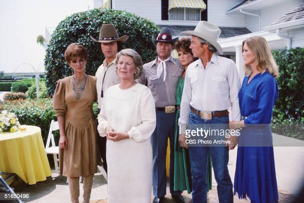 In a scene from the American television series 'Dallas cast members gather on the porch of a large house Dallas Texas 1981 From left American actors...