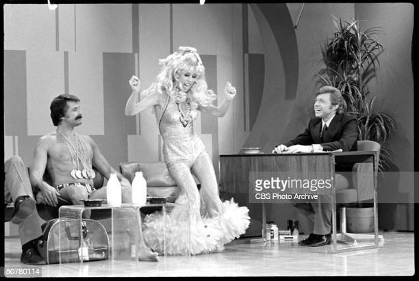 In a scene from 'The Carol Burnett Show' American comedian and actror Steve Lawrence as a TV show host interviews Charo and Olympic swimmer Mark...