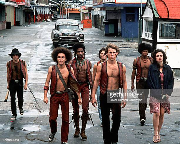 In a scene from the film 'The Warriors' members of the titular gang walk west along Bowery Street in Coney Island New York New York 1979 Pictured are...