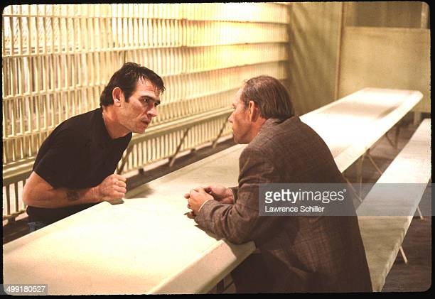 In a scene from the madefortelevision movie 'The Executioner's Song' American actor Tommy Lee Jones speaks with actor Rance Howard in a prison Provo...