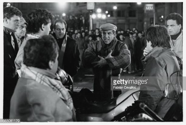 In a scene from the movie 'Lui e peggio di me' directed by Enrico Oldoini actor and singer Adriano Celentano wearing a cap talks to Renato Pozetto...