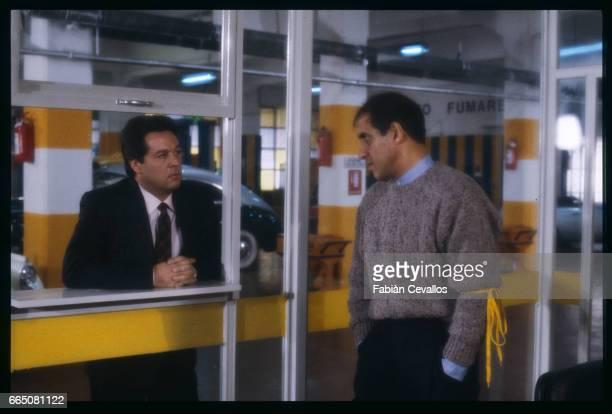 In a scene from the movie 'Lui e peggio di me' directed by Enrico Oldoini actors Renato Pozzetto and Adrinao Celentano talk to each other in a garage...