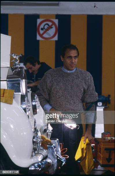 In a scene from the movie 'Lui e peggio di me' directed by Enrico Oldoini actor Adriano Celentano stands next to a white vintage car with a lamp in...
