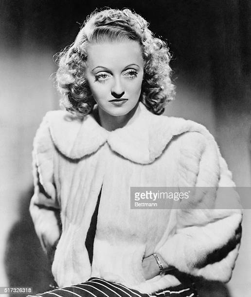 In a season of elegance casually cut jackets of precious and semiprecious furs are eyecatching This smart evening model worn by actress Bette Davis...