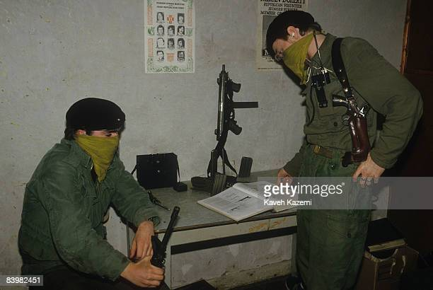 In a secret location in County Donegal in the Irish Republic trainee members of the Provisional Irish Republican Army go through assault rifle...