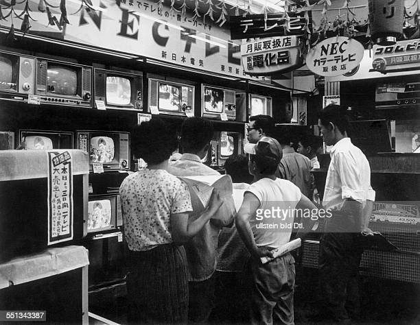 In a shop selling televisions in Tokyo by Claude Jacoby