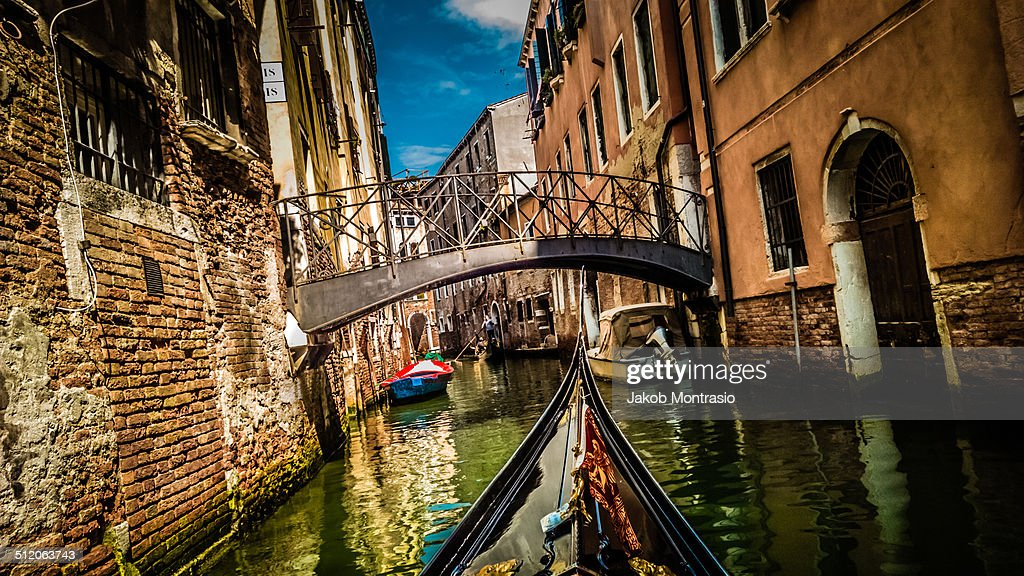 In a small canal in Venice on a Gondola : Stock Photo