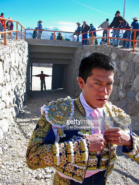In a small village called Yanque in Canyon del Colca, close to Chivay, a bull fighting event was held on a Monday. A young bull fighter was adjusting...
