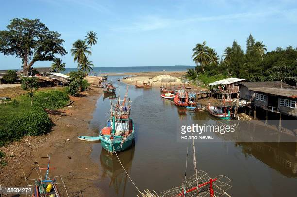 In a small village near Surat Thani fishing boats are resting waiting for better times