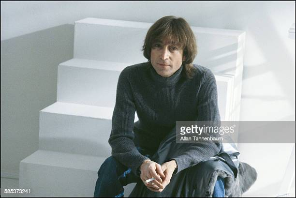 In a SoHo gallery British musician John Lennon sits on a step and smokes a cigarette New York New York November 26 1980 The gallery was one of...