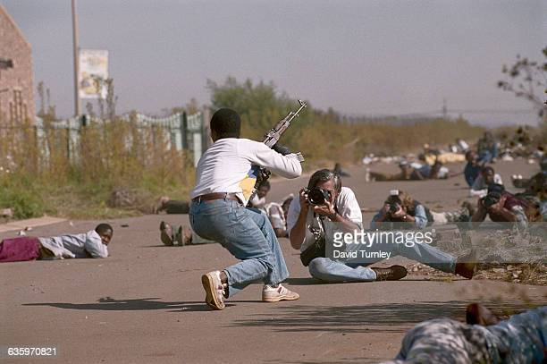 In a South African township in the East Rand photographer James Nachtwey works in the middle of a street battle between African National Congress...