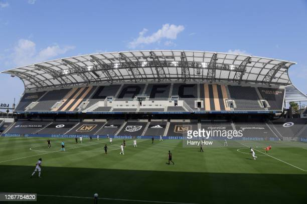 In a stadium without fans, Keeper Kenneth Vermeer of Los Angeles FC makes a pass during the second half in the opening game against the Los Angeles...
