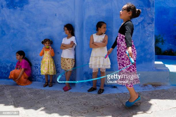 CONTENT] In a street of Chefchaouen Morocco