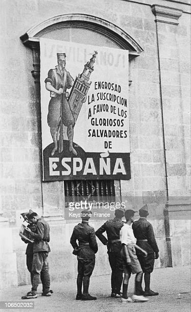 In A Street Of Seville A City Conquered By The Nationalist Forces At The Start Of The Conflict A Poster From Franco'S General Headquarters Calling...