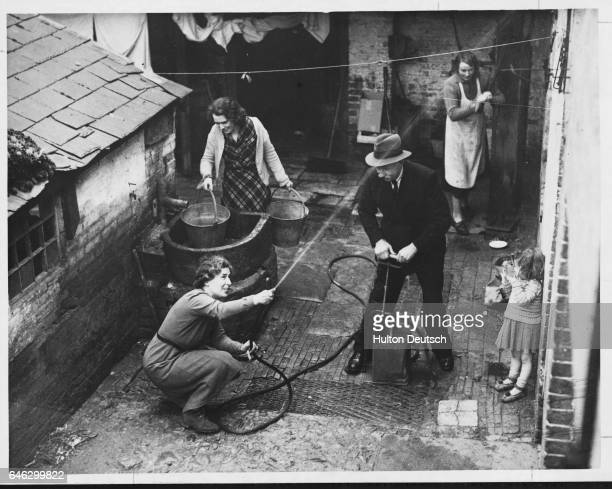 In a tiny village near Newbury Berks where water has to be pumped from wells some of the residents who have purchased stirrup pumps are putting in...