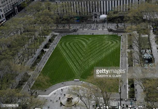In a tribute to healthcare workers first responders and essential workers the Bryant Park Corporation created a heart on its newly seeded 11acre lawn...