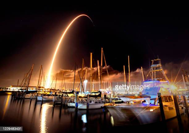 In a view from the Port Canaveral Yacht Club, the SpaceX Falcon 9 launches from nearby Cape Canaveral Air Force Station carrying a Lockheed-Martin...