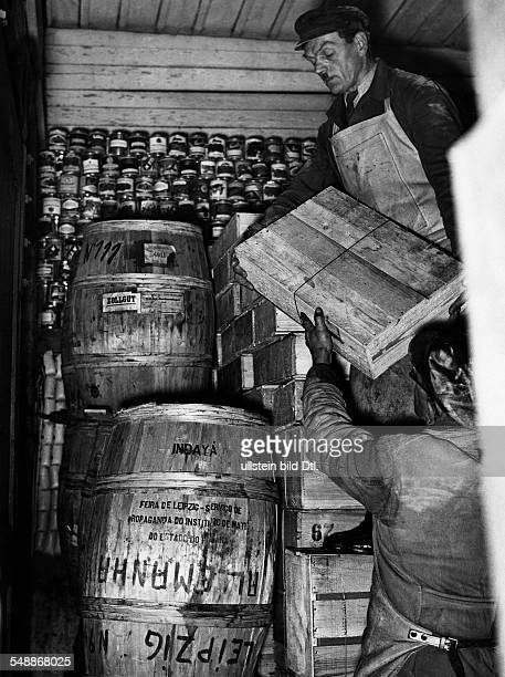 In a warehouse of the winter relief barrels filled with Mate tea from Brazil and canned goods Photographer Herbert Hoffmann 1937 Vintage property of...