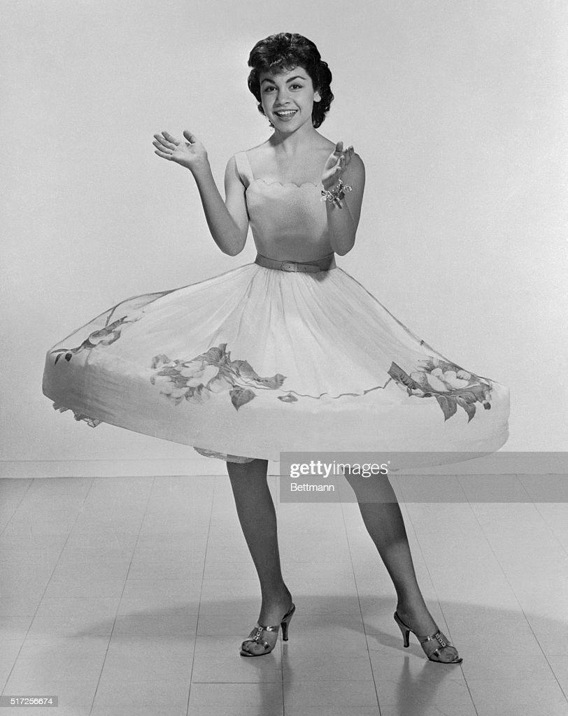 In a whirl, Annette Funicello shows off the beauty that the viewers have seen blossoming on their TV screens for the past four years. Now a sweet 16, Annette is the star of Walt Disney's Mickey Mouse Club series, where she started as a dimpled 12-yr-old. The five foot two inch brunette can't wait to grow up. She says ' I should be ready to play romantic parts by the time I'm 17.'