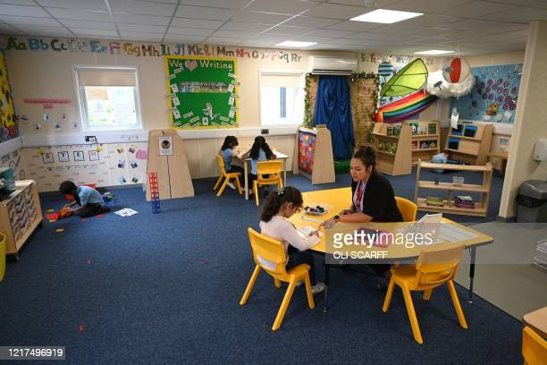 In a year 1 classroom, children are taught in a teaching environment safe from Coronavirus for pupils and teachers at Brambles Primary Academy in...