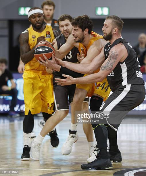 Ante Tomic #44 of FC Barcelona Lassa competes with Vladimir Veremeenko #14 and Janis Strelnieks #13 of Brose Bamberg BAMBERG GERMANY JANUARY 05 in...