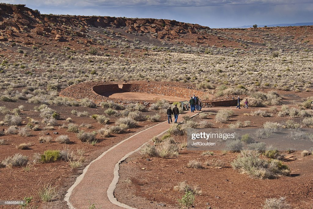Visitors Walk to the Ball Court Near Wupatki Pueblo : Stock Photo