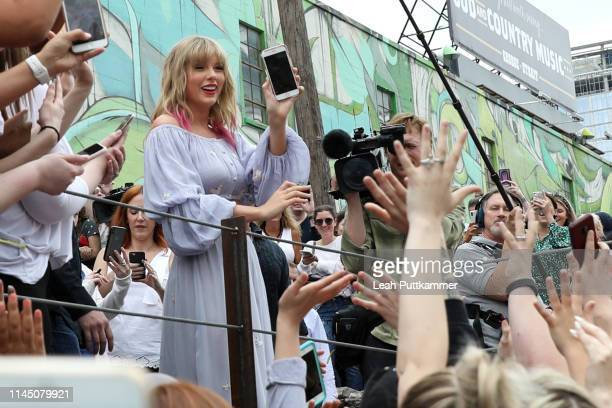 In advance of her new single 'Me Taylor Swift surprises fans at the new Kelsey Montague What Lifts You Up Mural on April 25 2019 in Nashville...