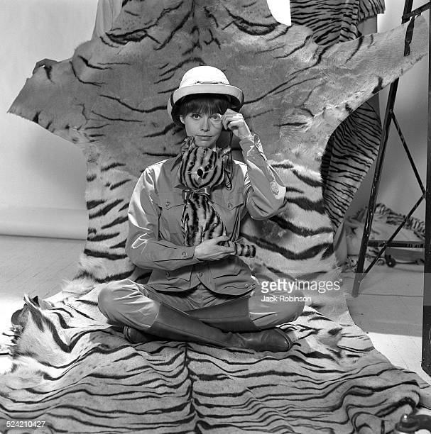 In advertisement for Revlon American actress Barbara Feldon poses dressed in jungle garb and seated on tiger fur New York New York 1965