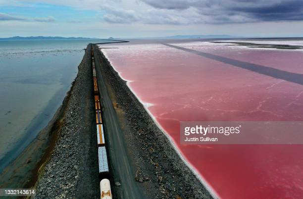 In an aerial view, a railroad causeway divides the Great Salt Lake on August 02, 2021 near Corinne, Utah. As severe drought continues to take hold in...