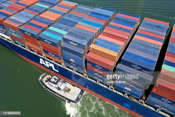 In an aerial view, an APL container ship pulls into the Port of Oakland on May 07, 2021 in Oakland, California. The Port of Oakland reported a record...