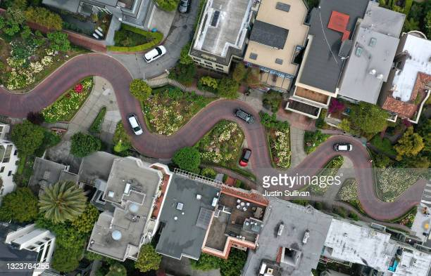 In an aerial view, cars drive along the Lombard Street tourist destination on June 14, 2021 in San Francisco, California. California, the first state...