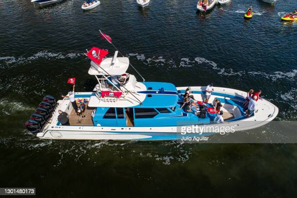 In an aerial view from a drone, a boat carrying head coach Bruce Arians of the Tampa Bay Buccaneers leads the way during the Tampa Bay Buccaneers...