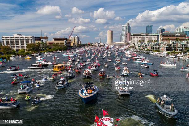 In an aerial view from a drone, a boat carrying Tom Brady of the Tampa Bay Buccaneers makes its way down the Hillsborough river during the Tampa Bay...