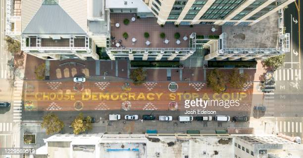 In an aerial view from a drone a mural that reads Choose Democracy Stop a Coup is seen painted on 14th Street on November 10 2020 in downtown Oakland...