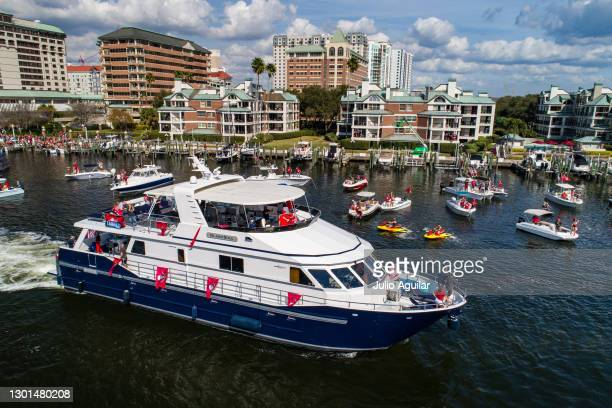 In an aerial view from a drone, a yacht carrying the Glazer family, owners of the Tampa Bay Buccaneers, makes its way down the Hillsborough river...