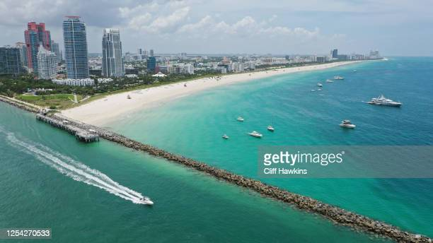 In an aerial view from a drone, Boats are anchored off of the closed beach on July 04, 2020 in the South Beach neighborhood of Miami Beach, Florida....