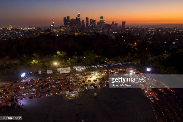 In an aerial view from a drone, cars line up at Dodger Stadium for COVID-19 testing on November 14, 2020 in Los Angeles, California. After California...