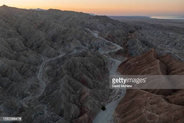 In an aerial view from a drone, colorful minerals are seen on the Pacific Plate side of the San Andreas Fault, where it collides with the North...