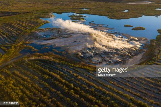 In an aerial view from a drone, fumaroles are seen in an area of cultivated cattail swamps to mitigate air pollution threat at the Salton Sea on...