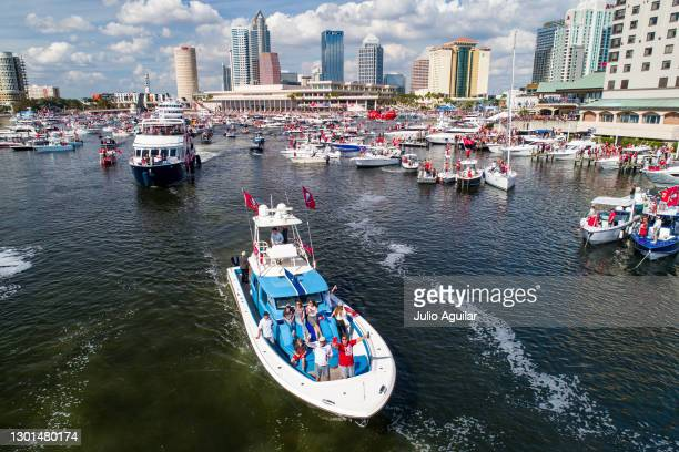 In an aerial view from a drone, head coach Bruce Arians of the Tampa Bay Buccaneers waves to fans during the Tampa Bay Buccaneers Super Bowl Victory...