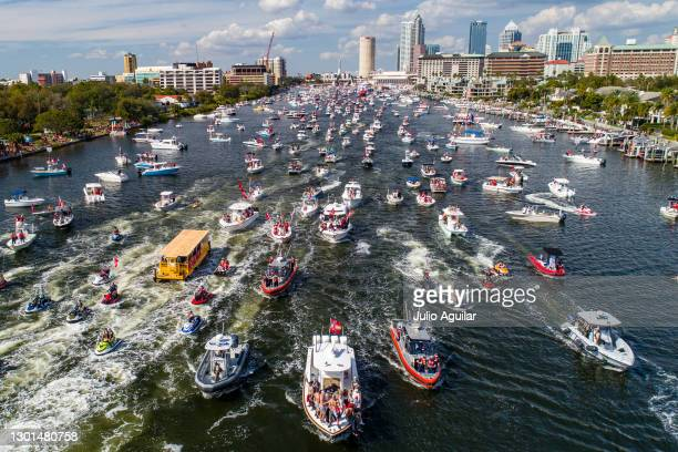 In an aerial view from a drone, Mike Evans and Rob Gronkowski of the Tampa Bay Buccaneers ride in a boat with the Lombardi trophy during the Tampa...