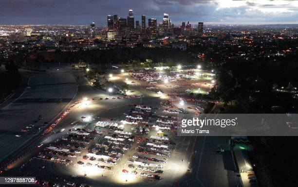 In an aerial view from a drone, motorists are lined up to receive vaccines at a mass COVID-19 vaccination site at Dodger Stadium, with the downtown...