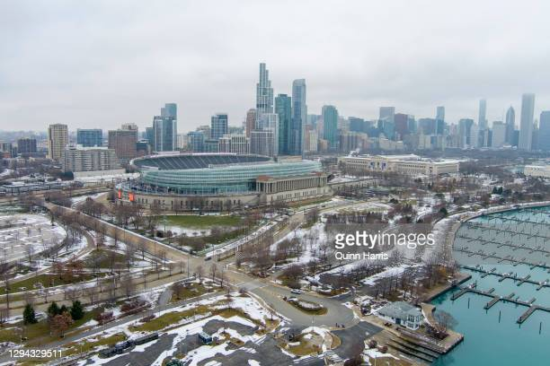 In an aerial view from a drone, Soldier Field is seen with the Chicago skyline in the background before the game between the Green Bay Packers and...