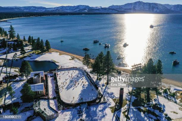 In an aerial view from a drone, the Boston Bruins and the Philadelphia Flyers warm-up prior to the 'NHL Outdoors At Lake Tahoe' at the Edgewood Tahoe...