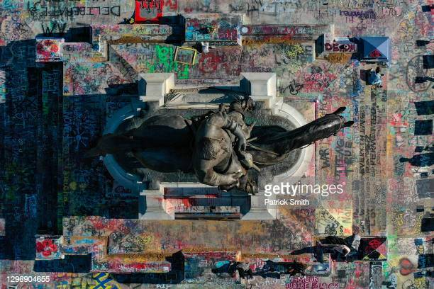 In an aerial view from a drone, the Confederate Gen. Robert E. Lee statue on Monument Avenue is seen on January 17, 2021 in Richmond, Virginia. Roads...