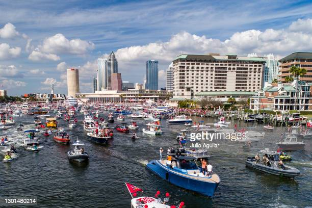 In an aerial view from a drone, Tom Brady of the Tampa Bay Buccaneers waves to fans during the Tampa Bay Buccaneers Super Bowl Victory Boat Parade on...