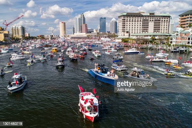 In an aerial view from a drone, Tom Brady of the Tampa Bay Buccaneers poses for a picture during the Tampa Bay Buccaneers Super Bowl Victory Boat...