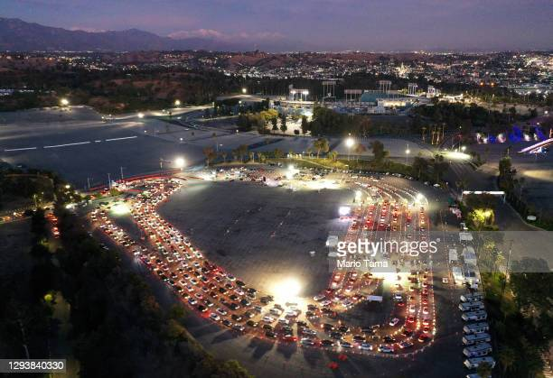 In an aerial view from a drone, vehicles line up at a COVID-19 testing site at Dodger Stadium ahead of the New Year's holiday on December 30, 2020 in...