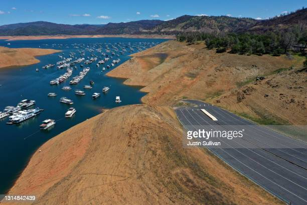 In an aerial view, houseboats are dwarfed by the steep banks of Lake Oroville on April 27, 2021 in Oroville, California. Four years after then...