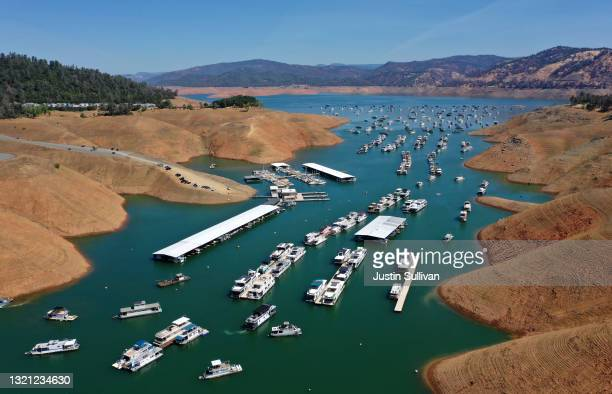 In an aerial view, houseboats sit anchored at the Bidwell Canyon Marina on Lake Oroville on June 01, 2021 in Oroville, California. As water levels...